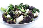 Steamed purple broccoli with goat's cheese