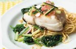Pan-fried fish with spinach and noodles
