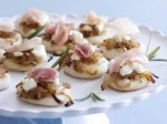 Pizzettes with Caramelized Onions, Goat Cheese, and Prosciutto