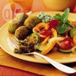 Braised vegetables with falafel and yogurt sauce