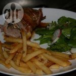 Stuffed Pork with Mushrooms wrapped in Pancetta with Fries and a Lettuce and Radish Salad