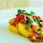 Grilled polenta with spicy sausage and veg sauce