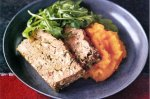 Green olive and mixed herb meatloaf on pumpkin puree