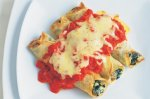 Silver beet & ricotta crepes with tomato sauce