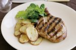 Caramelised pork cutlets with golden potatoes
