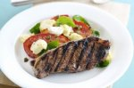 Balsamic steak with tomato, basil and fetta
